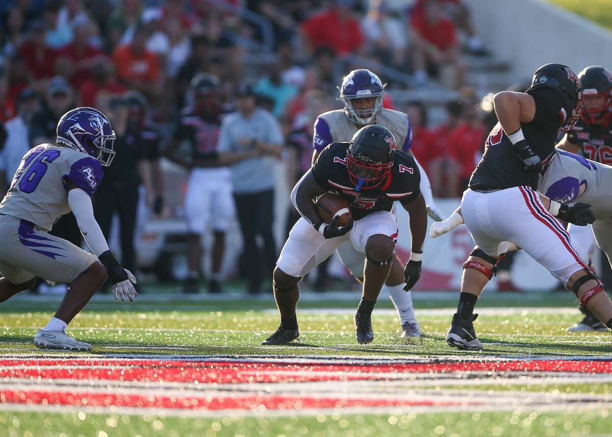 Lamar running back Chaz Ward (7) escapes a tackle Saturday at Provost Umphrey Stadium in Beaumont, TX. Photo taken September 25, 2021 Jarrod Brown for Beaumont Enterprise