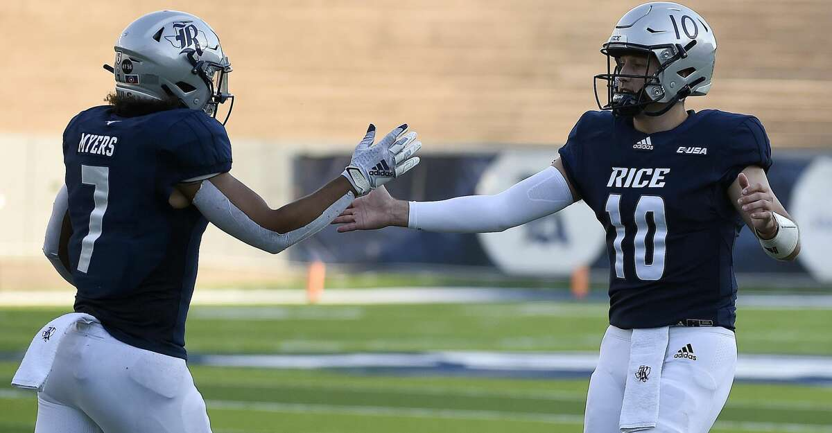 Rice tight end Jordan Myers (7) celebrates his touchdown with quarterback Jake Constantine during the first half of an NCAA college football game against Texas Southern, Saturday, Sept. 25, 2021, in Houston.