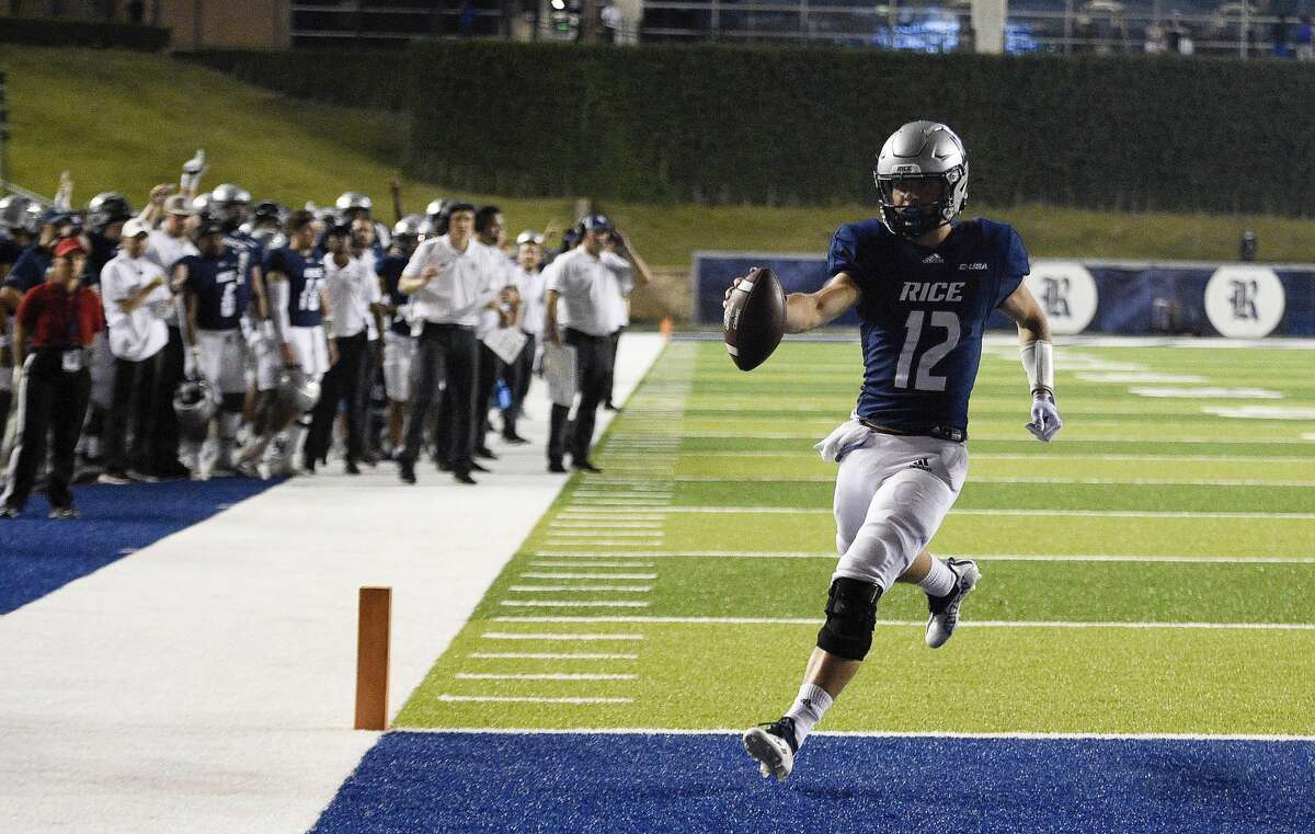 Rice quarterback Luke McCaffrey (12) runs into the end zone for a touchdown during the second half of an NCAA college football game against Texas Southern, Saturday, Sept. 25, 2021, in Houston.