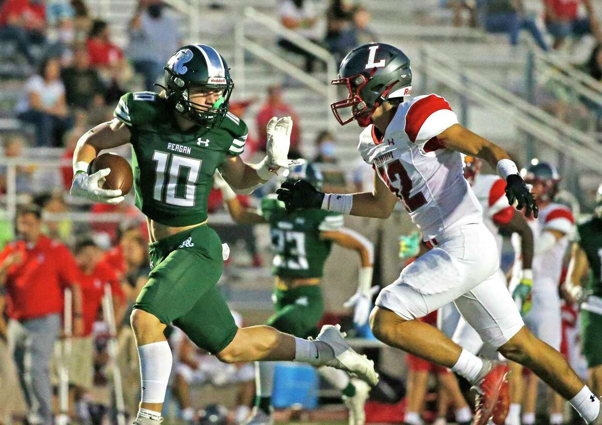 Reagan wide receiver Luke Sasser (10) avoids the tackle of LEE's Diego Ponce for a touchdown on Saturday, Sept. 25, 2021.