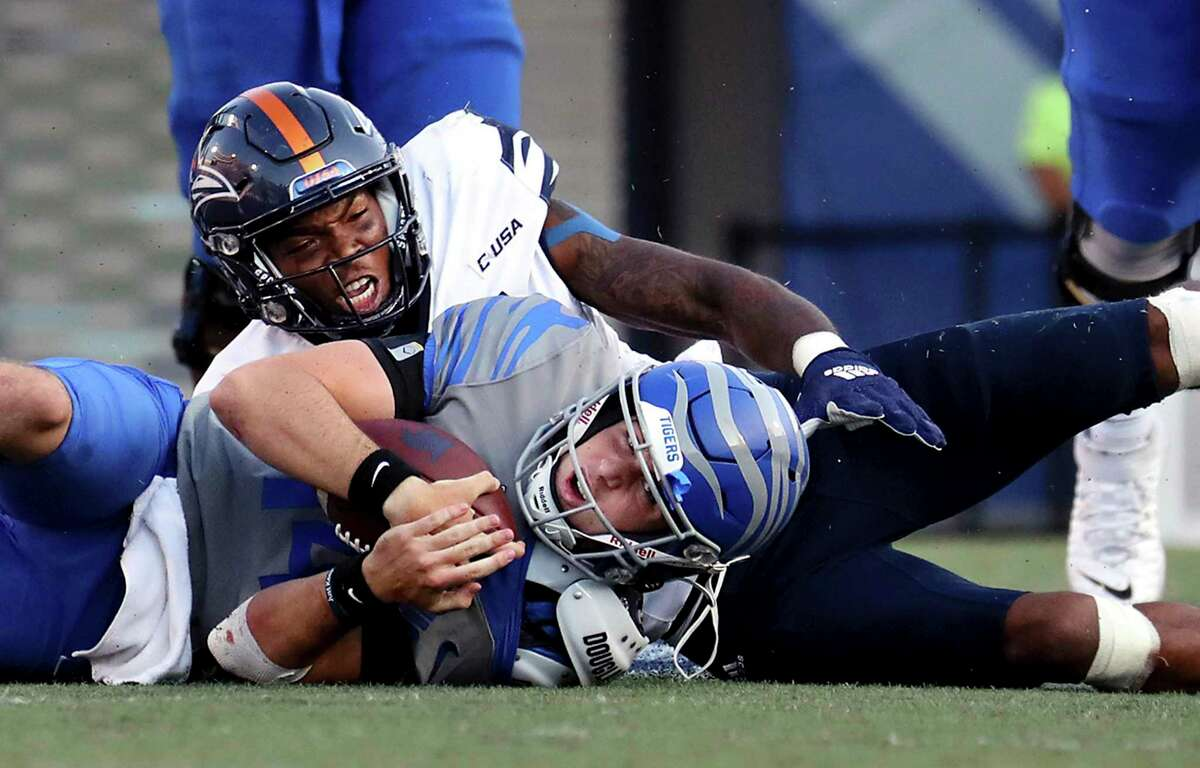 Memphis quarterback Seth Henigan (14) gets brought down by UTSA safety Clifford Chattman (10) during an NCAA college football game, Saturday, Sept. 25, 2021 in Memphis, Tenn.. (Patrick Lantrip/Daily Memphian via AP)