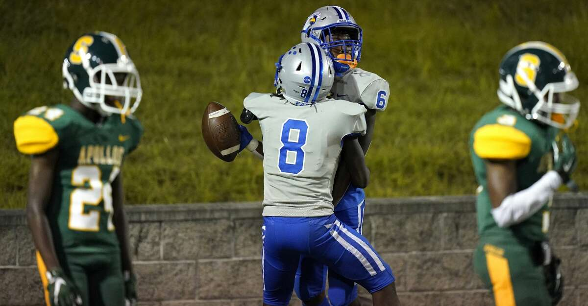 Willowridge (6) Marxquise Hayes celebrates his overtime touchdown with (8) Javin Chatman during game against Sharpstown at Delmar Stadium Saturday, Sept. 25, 2021 in Houston.