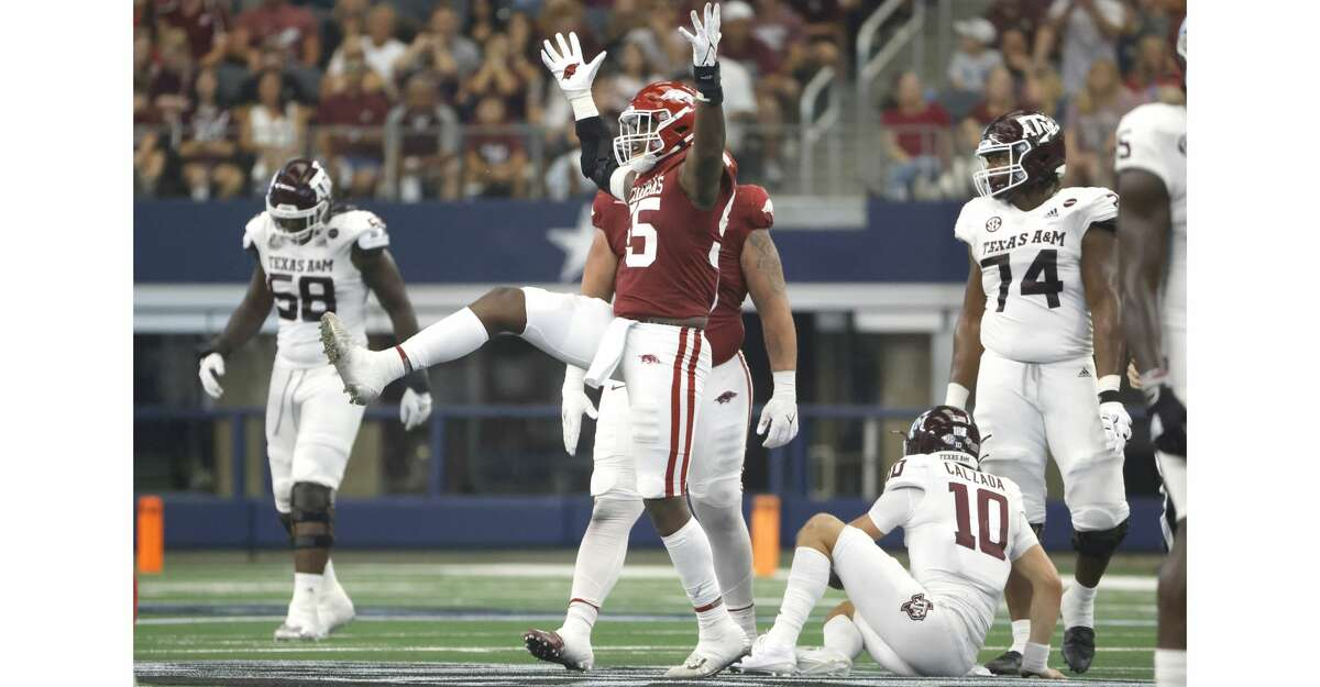 Tre Williams #55 of the Arkansas Razorbacks reacts after taking down Zach Calzada #10 of the Texas A&M Aggies in the first half of the Southwest Classic at AT&T Stadium on September 25, 2021 in Arlington, Texas. Arkansas won 20-10. (Photo by Ron Jenkins/Getty Images)