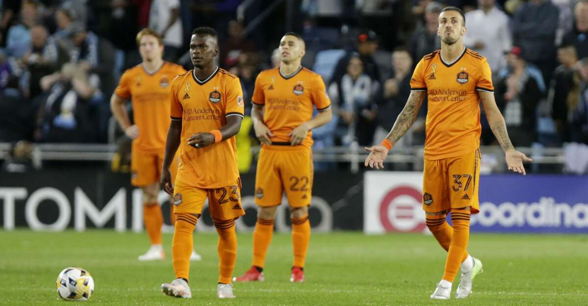 Houston Dynamo forward Maximiliano Urruti (37), forward Carlos Darwin Quintero (23) and midfielder Matias Vera (22) react after Minnesota United scored in the first minute during the first half of an MLS soccer match, Saturday, Sept. 25, 2021, in St. Paul, Minn. (AP Photo/Andy Clayton-King)