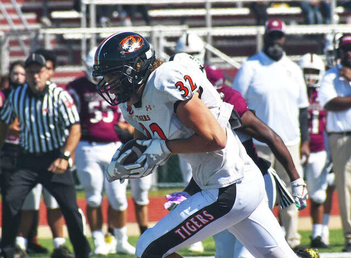 Edwardsville linebacker Colten Carstens returns a fumble 48 yards for a touchdown on the opening series of the game against Belleville West on Saturday in Belleville.
