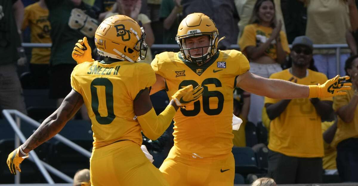 Baylor tight end Ben Sims (86) celebrates his touchdown with wide receiver R.J. Sneed (0) during the first half of an NCAA college football game against Iowa State, Saturday, Sept. 25, 2021, in Waco, Texas. (AP Photo/Jim Cowsert)