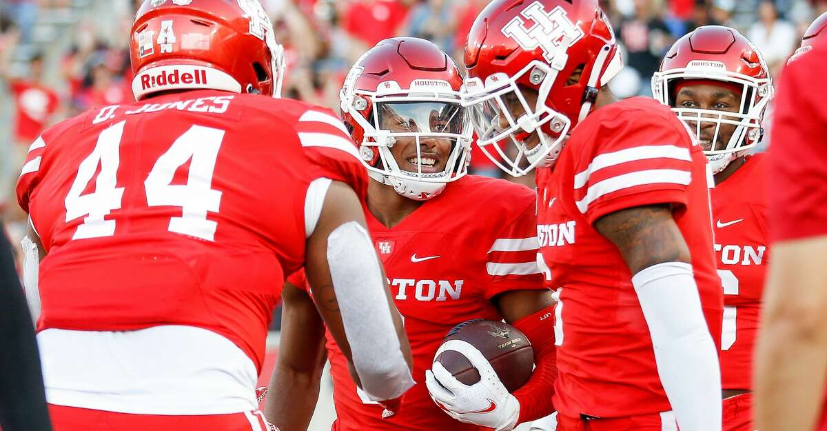 Houston Cougars cornerback Marcus Jones (8) celebrates after returning a punt for a 73-yard touchdown against the Navy Midshipmen during the first quarter of an NCAA game at TDECU Stadium on Saturday, Sept. 25, 2021, in Houston.