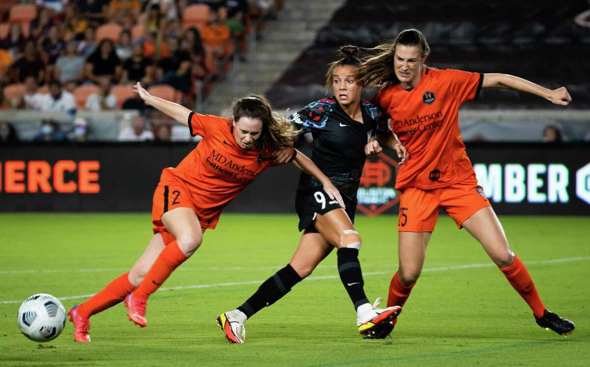 Houston Dash defender Allysha Chapman (2), left, Chicago Red Stars forward Mallory Pugh (9), center, and Houston Dash defender Katie Naughton (25) battle for the ball during the second half of the game at BBVA Stadium, Friday, Sept. 10, 2021, in Houston. The game ended in a tie 1-1.
