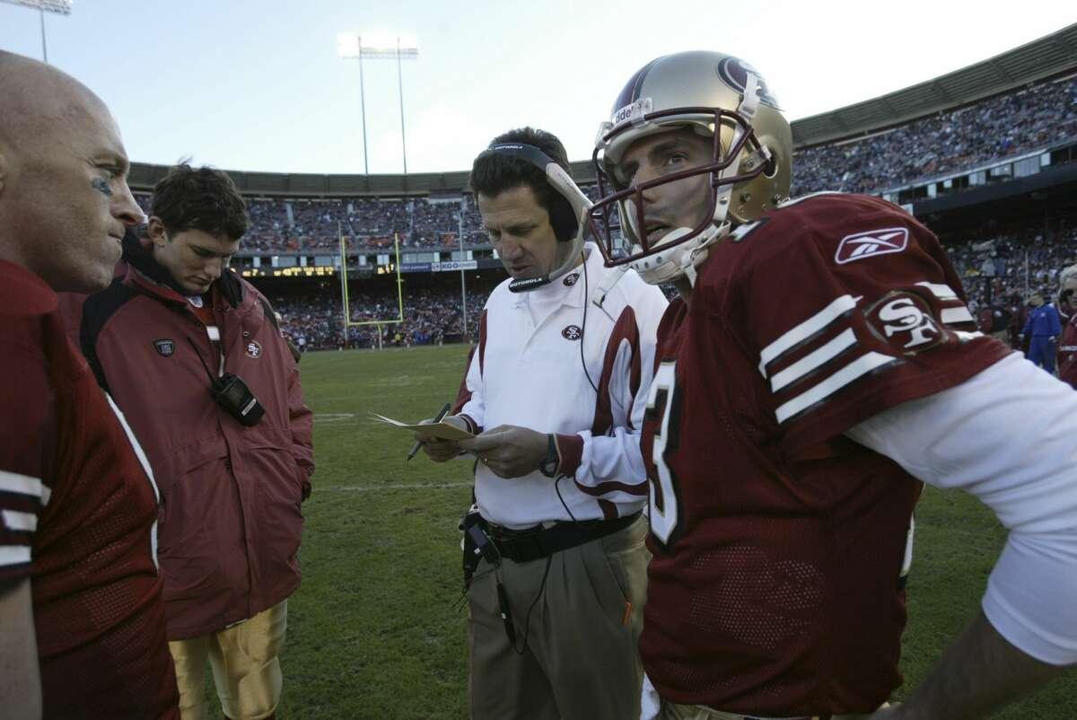 FILE: San Francisco 49ers quarterback Tim Rattay with Greg Knapp (center) and Jeff Garcia at 3Com Park on Dec, 7, 2003 in San Francisco.