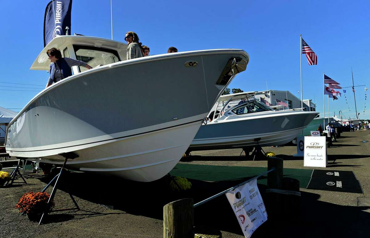 Visitors browse watercraft at The Norwalk Boat Show Saturday, September 25, 2021, at Cove Marina in Norwalk, Conn.