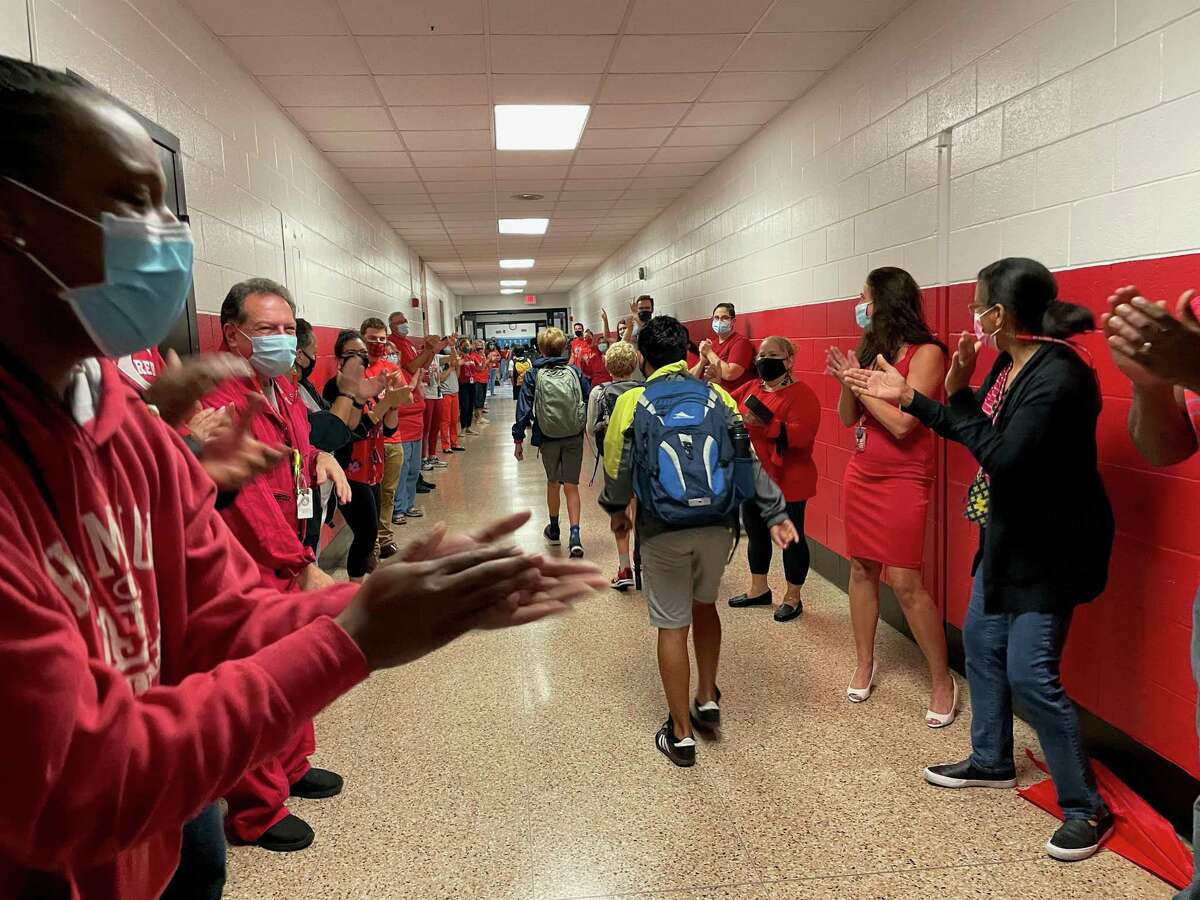 Students at Roton Middle School entered the building through a welcome tunnel of teachers, administrators and staff cheering for them. The celebration was part of a week-long program to prevent social isolation.