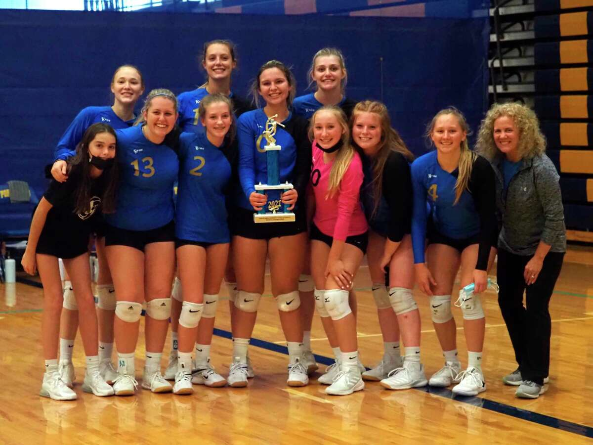 Onekama volleyball celebrates a championship at its home tournament on Saturday. (Courtesy photo/Megan McCarthy)