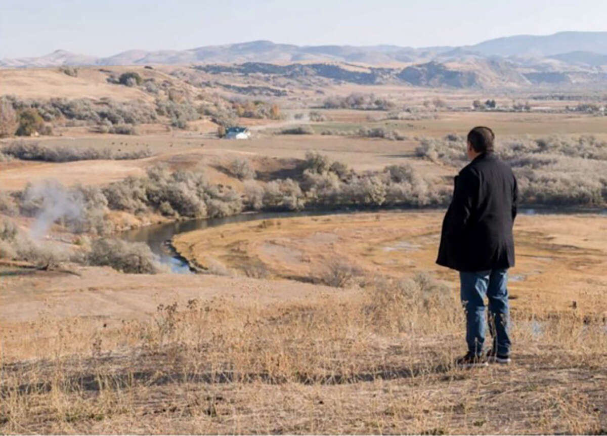 Darren Parry, the grandson of Mae T. Parry, looks out over the site where ancestors from his tribe - the Northwestern Band of the Shoshone Nation - were massacred in 1863 by the U.S. Army. Parry has been working to get more recognition for the site and helping on plans to build a facility that would honor those who were killed.