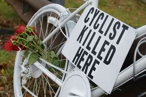 """A white-painted """"ghost bike"""" memorial in Bethel in 2013, at the scene where 59-year-old Weston resident Thomas Steinert-Threlkeld was killed in a hit-and-run accident. Some say motor vehicle-bicycle accidents have reached a criris and advocates are using that as an argument for a climate initiative."""