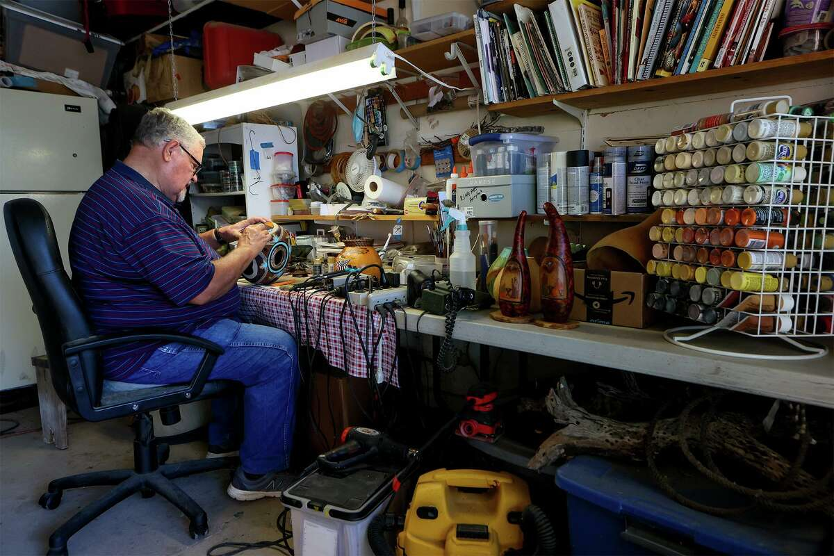Converse resident David Cleaveland puts the final touches on a dried gourd in his workshop garage on Friday, Sept. 17, for the upcoming Lone Gourd Festival in Fredericksburg next month. Cleaveland is president of the Texas Gourd Society that's hosting the annual event.