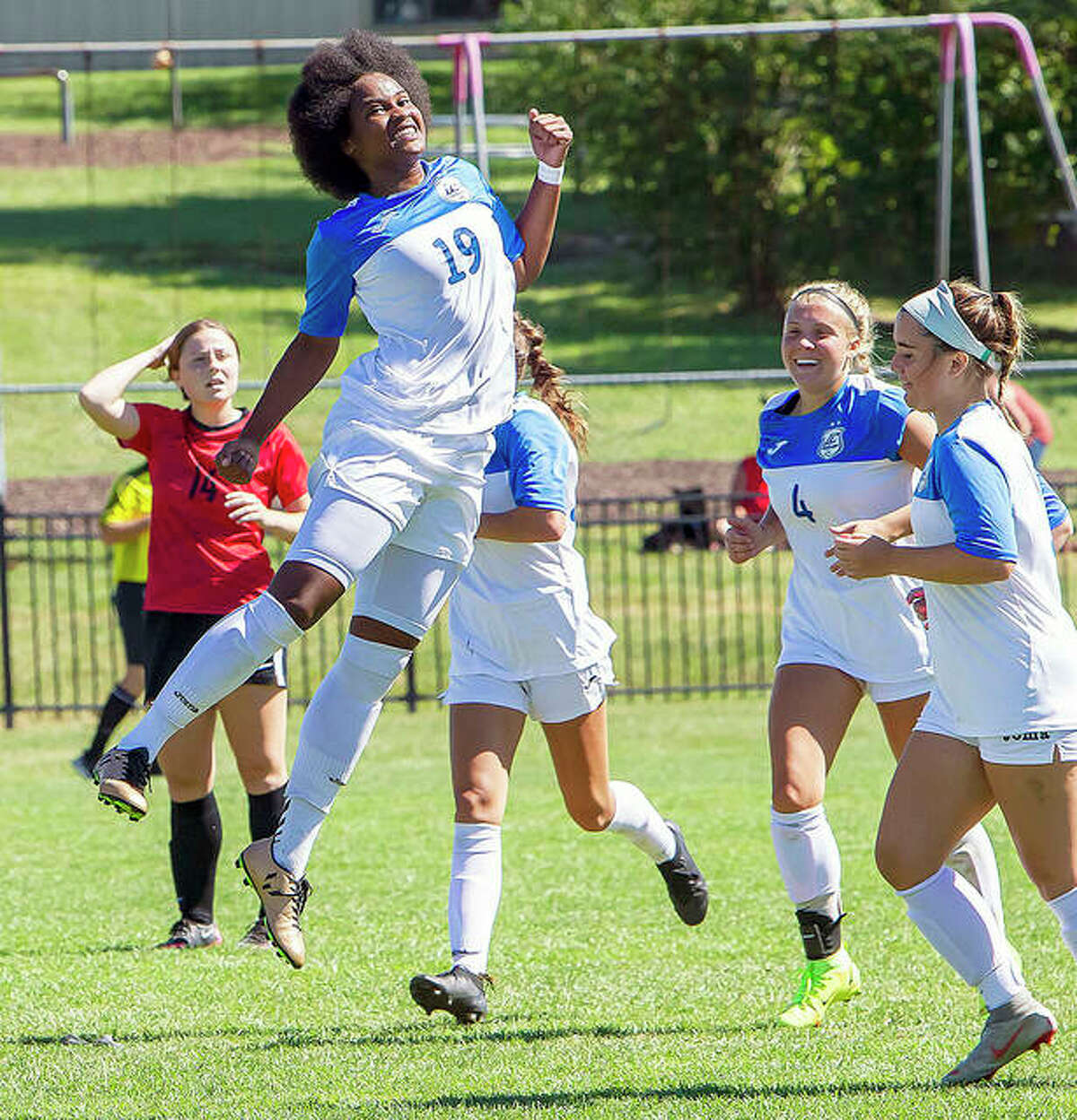 Freshman Chrissy Mitchell (19) leaps into the air to celebrate one of her two goals against Wabash Valley in Saturday's 2-0 Region 24 victory at Tim Rooney Stadium.