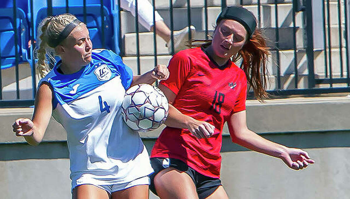 Skylar Hollingshead of Lewis and Clark (4) and Wabash Valley's Kyra Bivins (18) battle for possession of the ball in Saturday's 2-0 LCCC win at Tim Rooney Stadium.