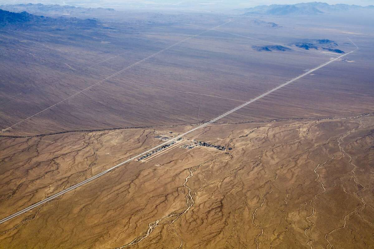 Kidwell Airport in the tiny town of Cal-Nev-Ari, Nevada as seen from the air. Highway 95 runs alongside.
