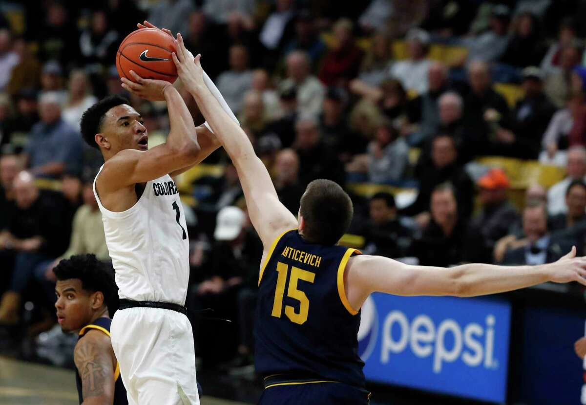 Colorado guard Tyler Bey, left, shoots for a basket over California forward Grant Anticevich in the second half of an NCAA college basketball game Thursday, Feb. 6, 2020, in Boulder, Colo. (AP Photo/David Zalubowski)