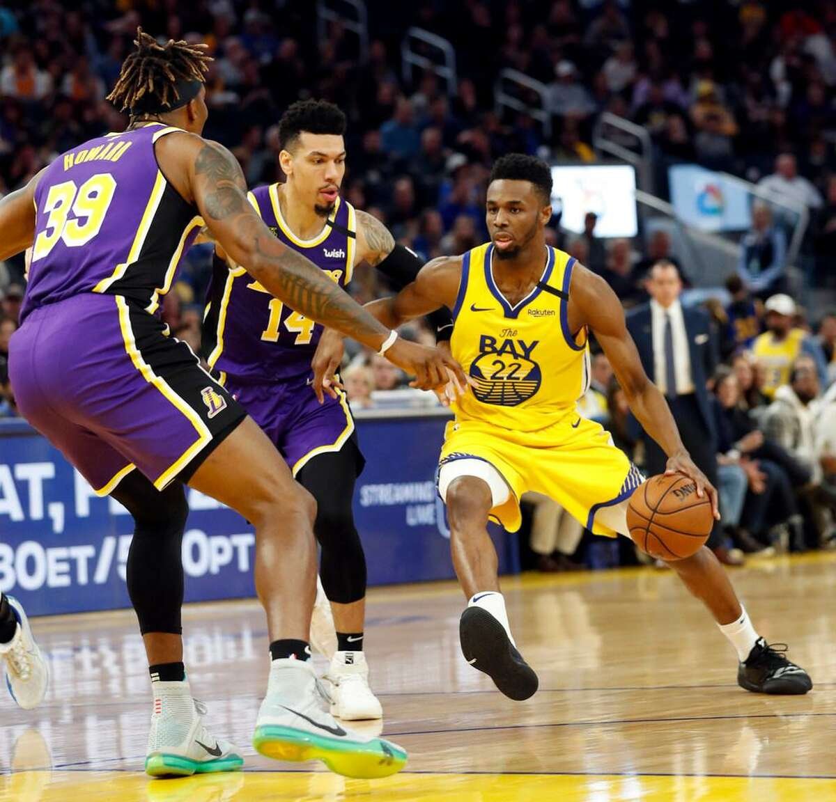 Golden State Warrior Andrew Wiggins (right) is one of the players who has refused to be vaccinated against COVID-19.