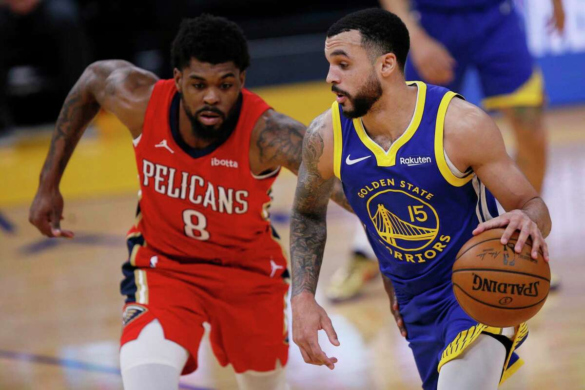 Golden State Warriors guard Mychal Mulder (15) dribbles against New Orleans Pelicans forward Naji Marshall (8) in the first quarter of an NBA game at Chase Center, Friday, May 14, 2021, in San Francisco, Calif.