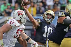 Drew Pyne (10) of the Notre Dame Fighting Irish passes over Jack Sanborn (57) of the Wisconsin Badgers at Soldier Field on September 25, 2021 in Chicago, Illinois. Notre Dame defeated Wisconsin 41-13. (Jonathan Daniel/Getty Images/TNS)