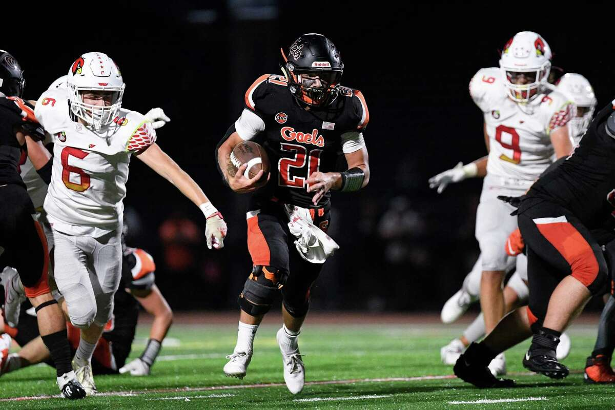 Shelton High's Tyler Rich hits the hole for a big gain against Greenwich High, Friday September 24, 2021