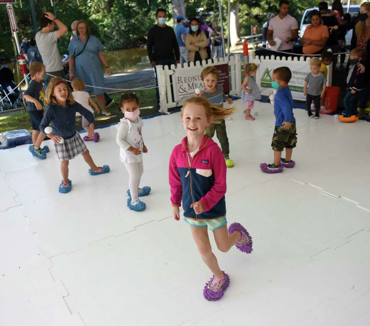 """Greenwich's Myla Scott, 6, """"skates"""" in the game zone at the first of three Fall Family Fest Sundays at the Stamford Museum & Nature Center in Stamford, Conn. Sunday, Sept. 26, 2021. To celebrate the season, the Museum & Nature Center held a mini festival with added attractions, enhanced programming, and fun offerings for the whole family. The event continues on Oct. 3 and Oct. 17."""