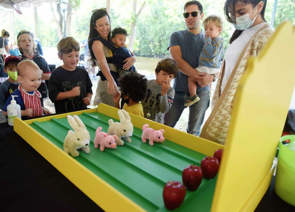 Kids watch their bunnies and pigs race at Porkchop Speedway at the first of three Fall Family Fest Sundays at the Stamford Museum & Nature Center in Stamford, Conn. Sunday, Sept. 26, 2021. To celebrate the season, the Museum & Nature Center held a mini festival with added attractions, enhanced programming, and fun offerings for the whole family. The event continues on Oct. 3 and Oct. 17.