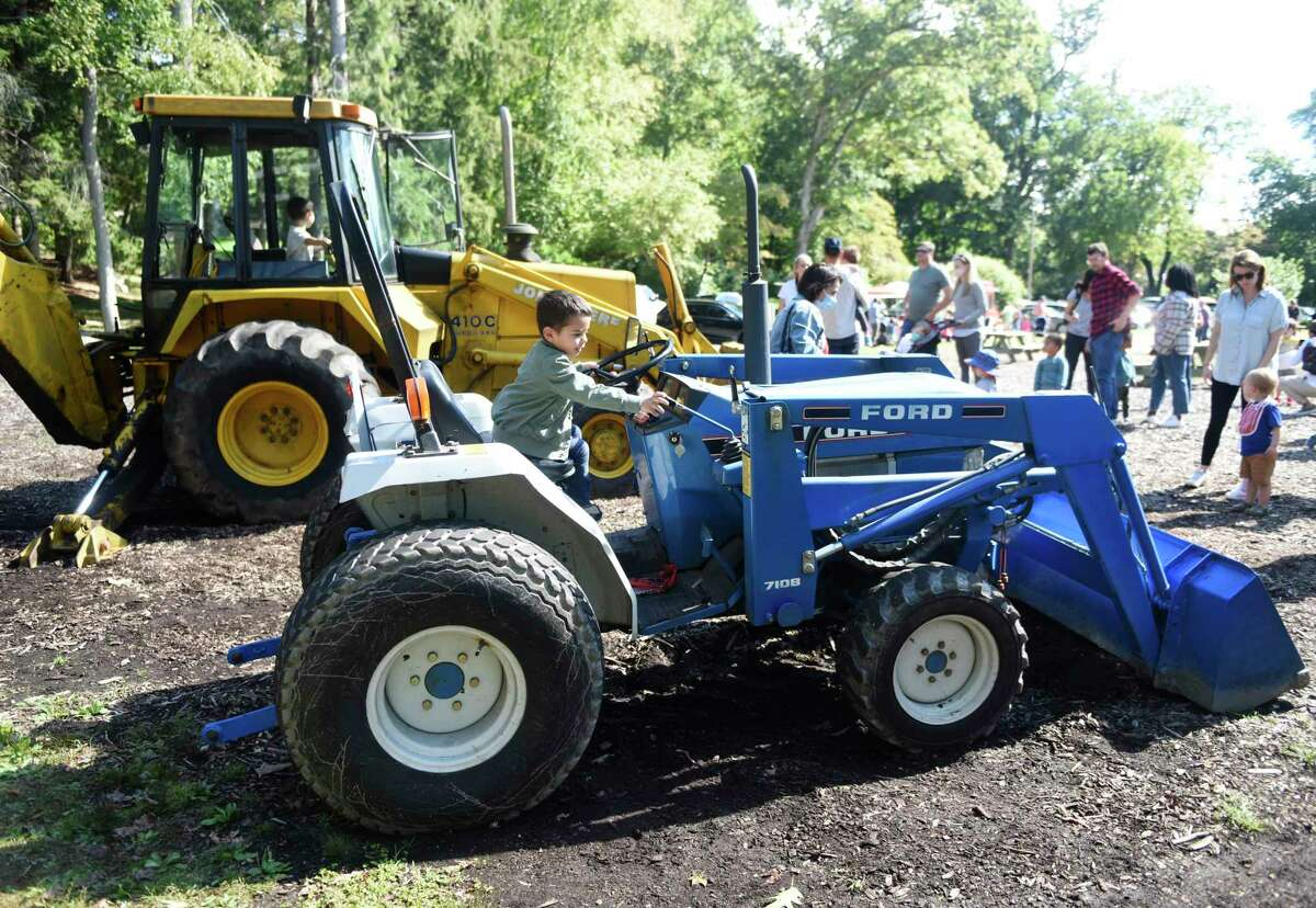 Norwalk's Victor Mora, 3, sits on a tractor at the first of three Fall Family Fest Sundays at the Stamford Museum & Nature Center in Stamford, Conn. Sunday, Sept. 26, 2021. To celebrate the season, the Museum & Nature Center held a mini festival with added attractions, enhanced programming, and fun offerings for the whole family. The event continues on Oct. 3 and Oct. 17.