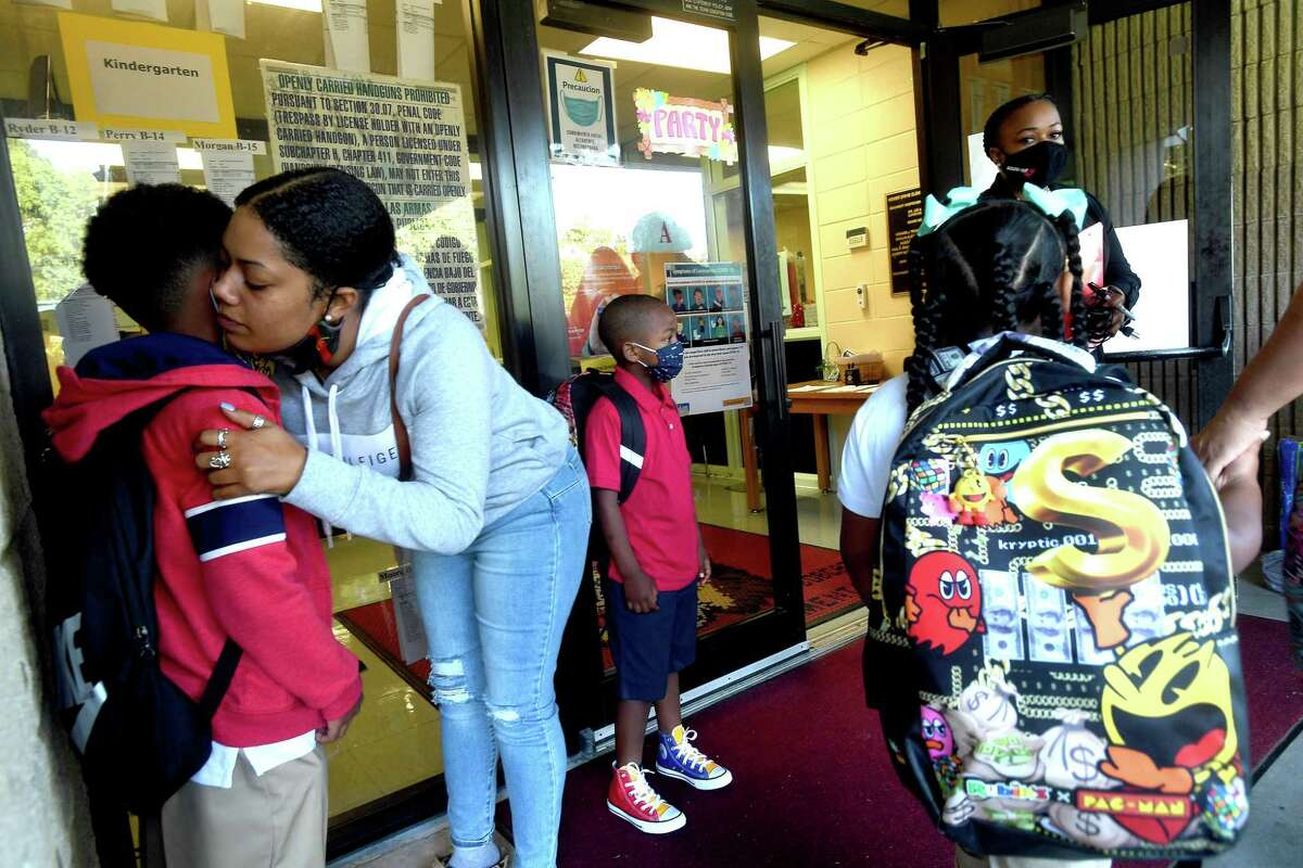 Briana Cormier hugs her son Jake Ross on the first day of school at Homer Drive Elementary. Photo made Tuesday, August 17, 2021 Kim Brent/The Enterprise