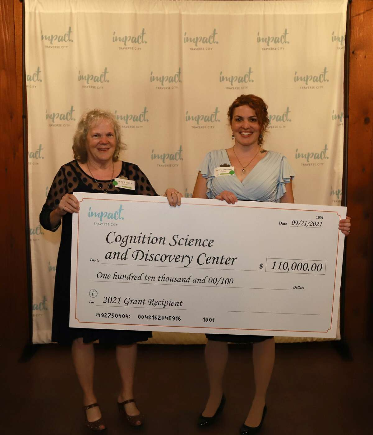 Laura Stanwick and daughter Kimmee Wenkel, founders of Cognition Science and Discovery Center, accept a $110,000 donation from Impact 100 of Traverse City.