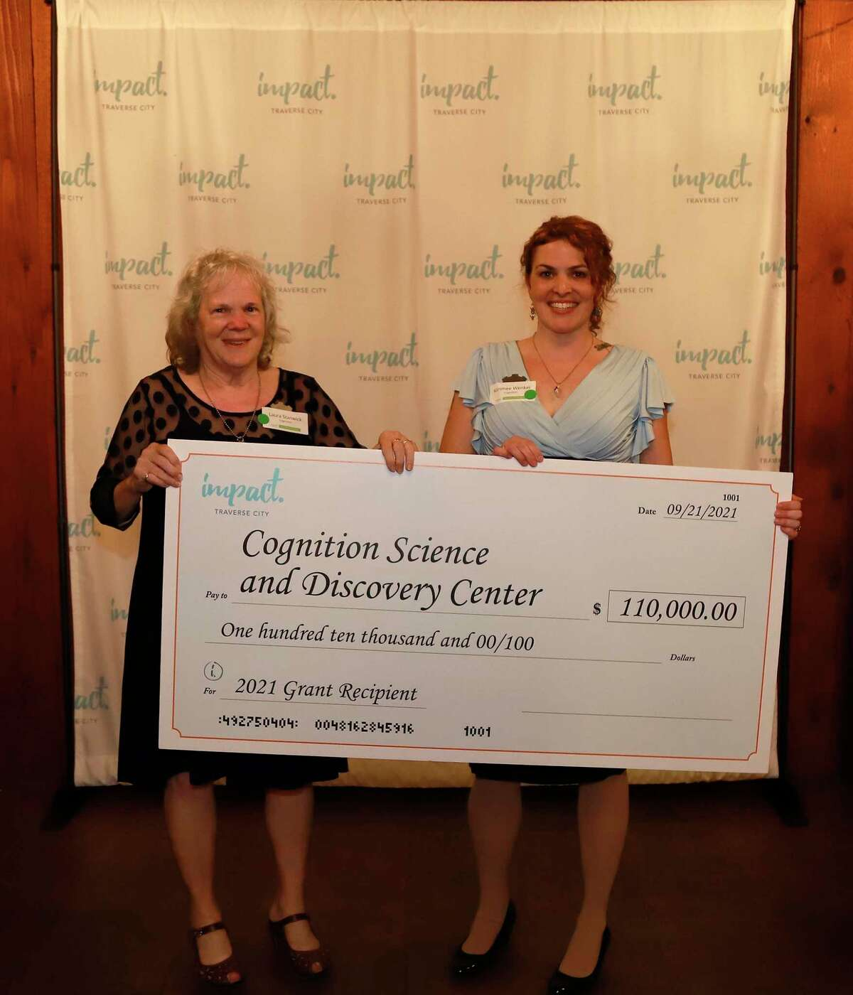 Laura Stanwick and daughter Kimmee Wenkel, founders of Cognition Science and Discovery Center, accept a $110,000 donation from Impact 100 of Traverse City. (Courtesy Photo)