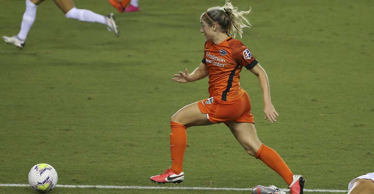 Houston Dash midfielder Bri Visalli (14) dribbles past Orlando Pride defender Carrie Lawrence (17) during the first half of a NWSL game Saturday, Sept. 26, 2020, at BBVA Stadium in Houston.