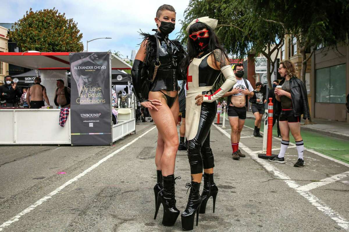 Katrina Black (left) and Alexandra Sadista, dominatrices from Chicago, attend the Folsom Street Fair, which required proof of vaccination against COVID-19.