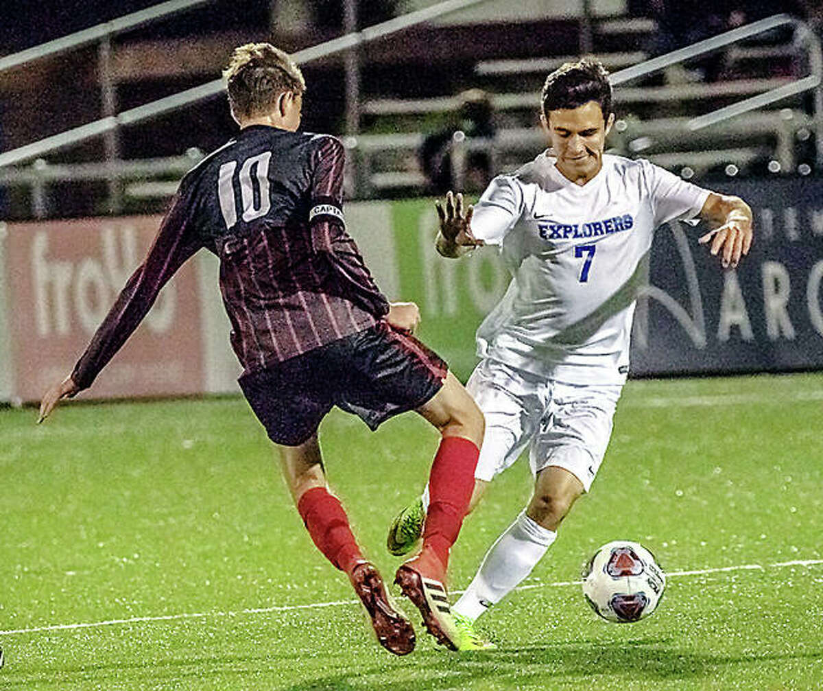 Jake Lombardi of Alton (10) and Marquette's Stephen Hasse go for the ball during 2018 CYC Tourney action at St. Louis Soccer Park. That was the last time Marquette and Alton's soccer teams faced each other. The last regular-season game between AHS and Marquette was in 2016.