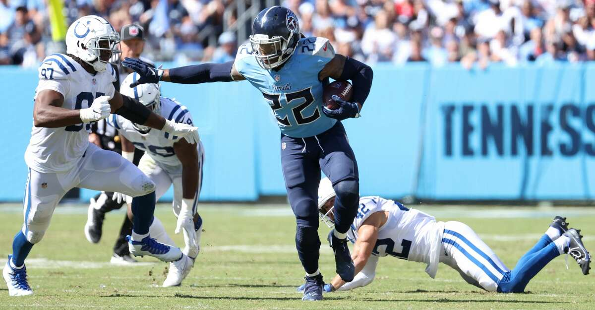 Derrick Henry #22 of the Tennessee Titans runs with the ball against the Indianapolis Colts in the second half of the game at Nissan Stadium on September 26, 2021 in Nashville, Tennessee. (Photo by Andy Lyons/Getty Images)