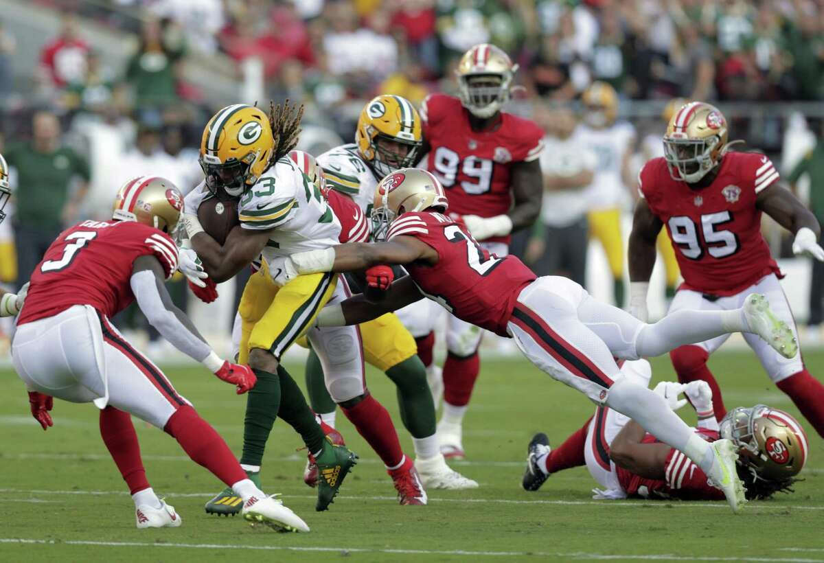 K'Waun Williams (24) goes for the tackle on Aaron Jones (33) in the first half as the San Francisco 49ers played the Greenbay Packers at Levi's Stadium in Santa Clara, Calif., on Sunday, September 26, 2021.