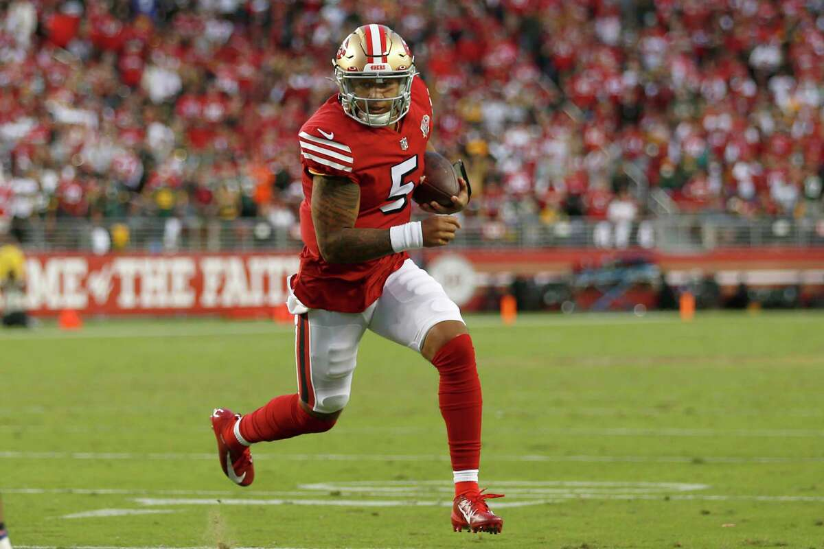 San Francisco 49ers quarterback Trey Lance (5) runs for a touchdown against the Green Bay Packers during the first half of an NFL football game in Santa Clara, Calif., Sunday, Sept. 26, 2021. (AP Photo/Jed Jacobsohn)