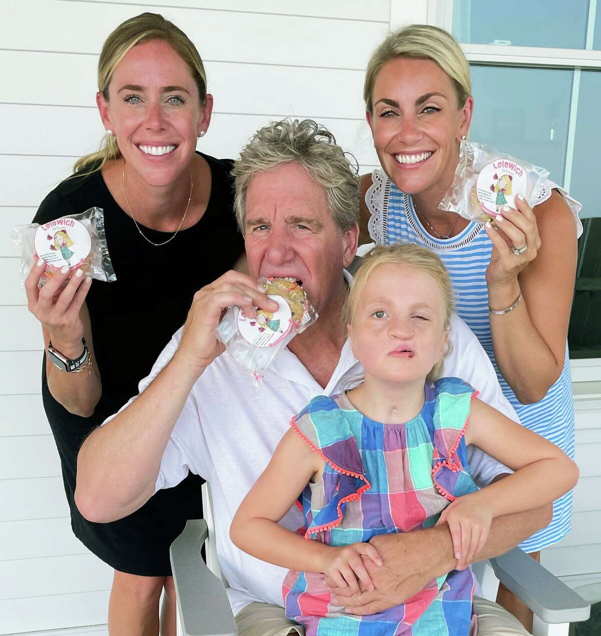 From left to right, enjoying a LoloWich are Kimberly Crowley, Melissa Shepley, Doug Rice and Lola.