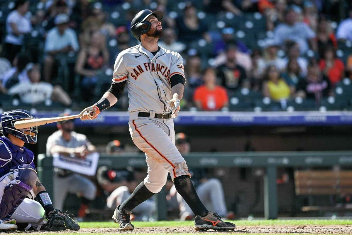 DENVER, CO - SEPTEMBER 26: Brandon Belt #9 of the San Francisco Giants hits a fifth inning double against the Colorado Rockies at Coors Field on September 26, 2021 in Denver, Colorado. (Photo by Dustin Bradford/Getty Images)