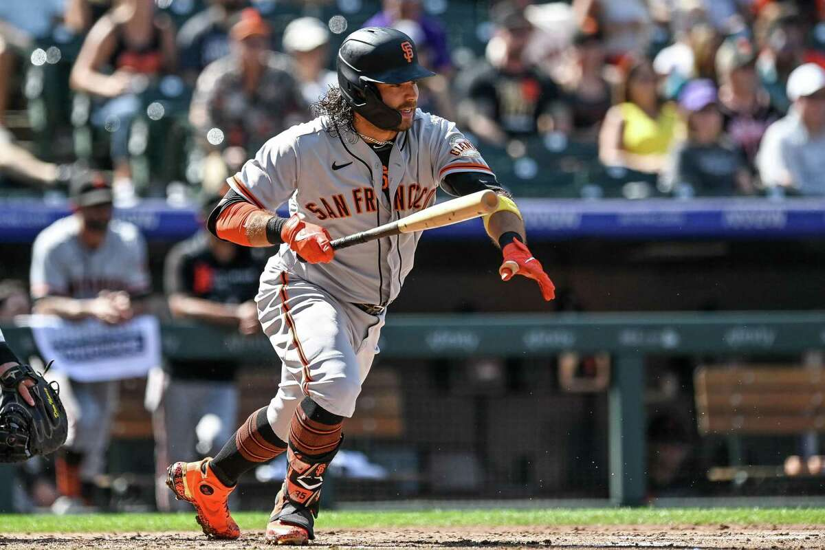 DENVER, CO - SEPTEMBER 26: Brandon Crawford #35 of the San Francisco Giants hits into a third inning run-producing ground out against the Colorado Rockies at Coors Field on September 26, 2021 in Denver, Colorado. (Photo by Dustin Bradford/Getty Images)