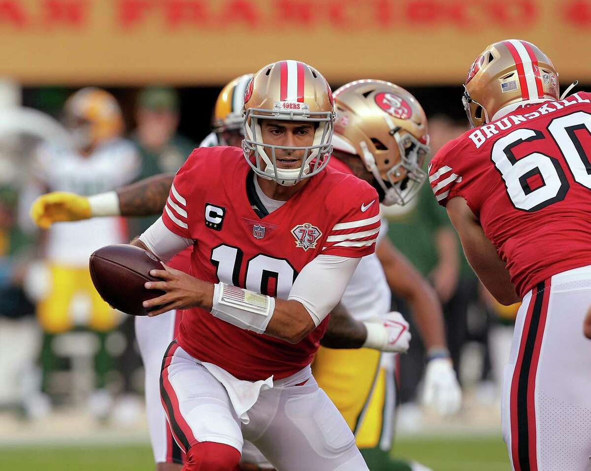Jimmy Garoppolo (10) prepares to hand off in the first half as the San Francisco 49ers played the Greenbay Packers at Levi's Stadium in Santa Clara, Calif., on Sunday, September 26, 2021.