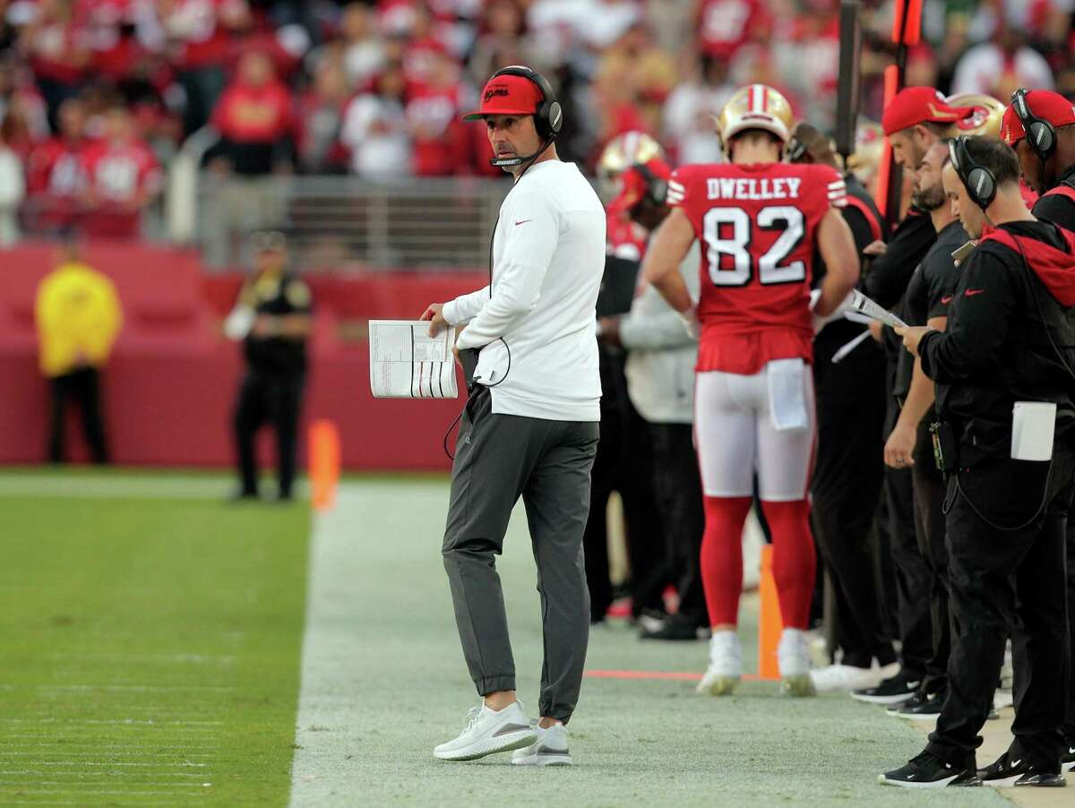 49ers head coach Kyle Shanahan walks the sidelines in the first half of San Francisco's 30-28 loss to the Packers.