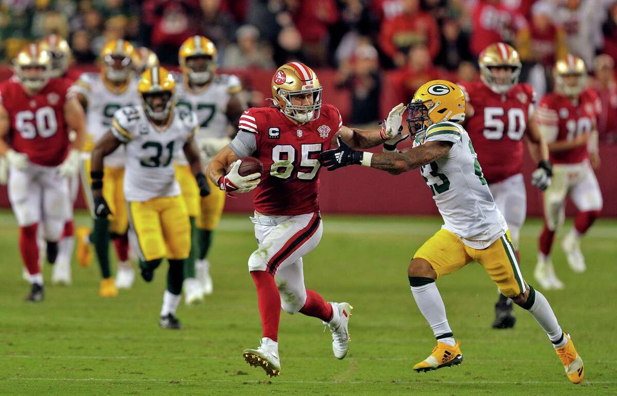 49ers tight end George Kittle stiff-arms Jaire Alexander after hauling in a big catch late in the fourth quarter of San Francisco's loss to Green Bay.