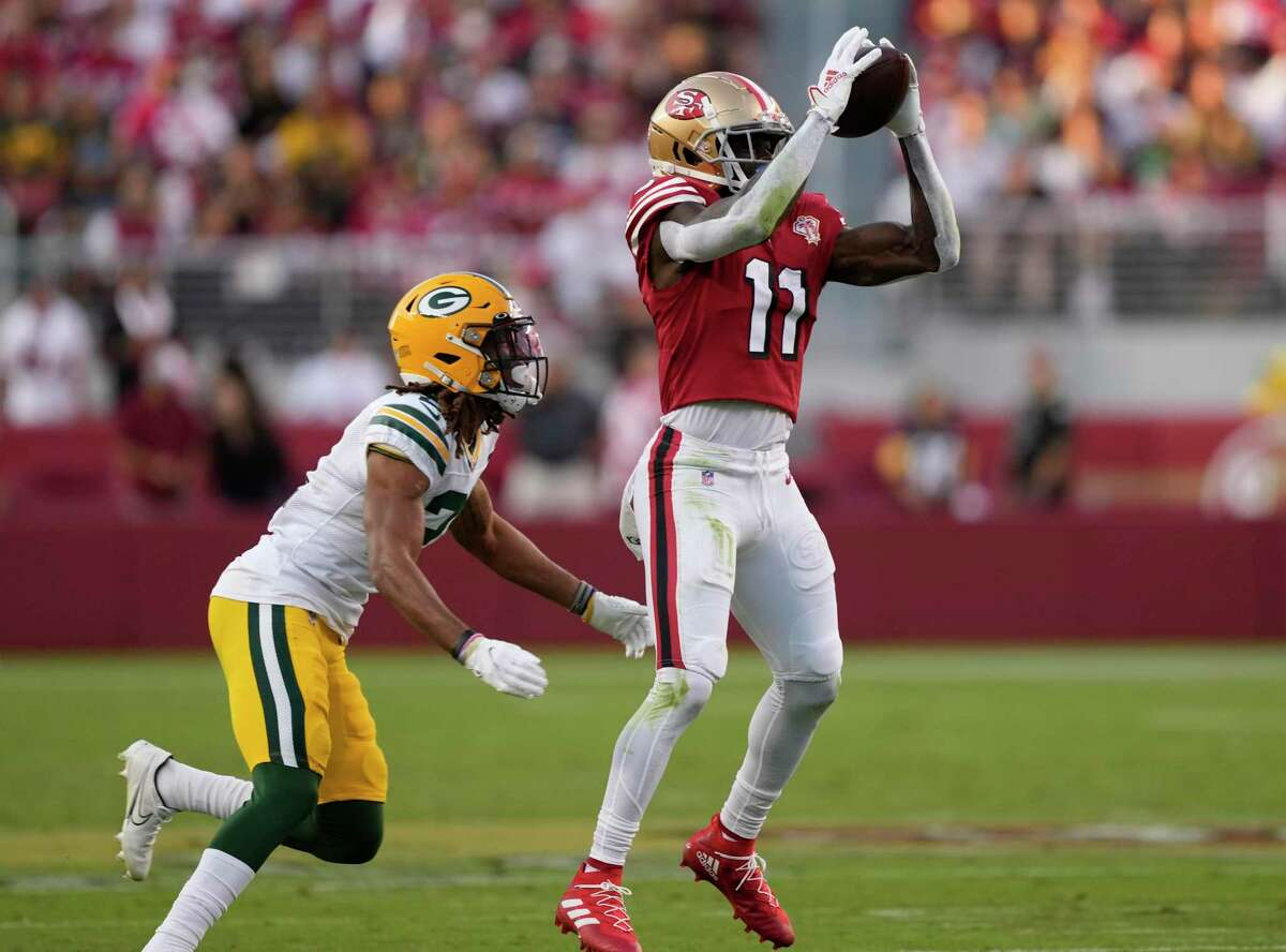 SANTA CLARA, CALIFORNIA - SEPTEMBER 26: Brandon Aiyuk #11 of the San Francisco 49ers catches a pass during the first half against the Green Bay Packers in the game at Levi's Stadium on September 26, 2021 in Santa Clara, California. (Photo by Thearon W. Henderson/Getty Images)