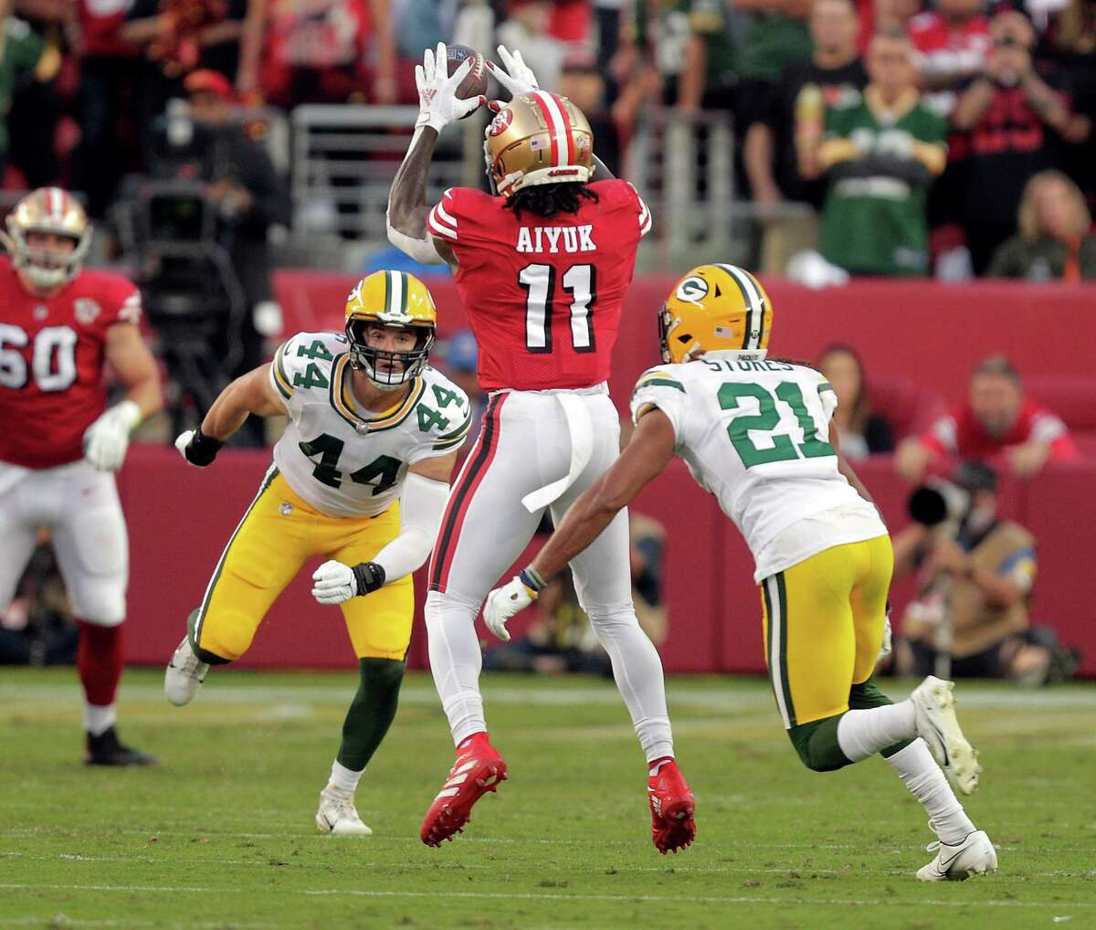 Brandon Ayuk (11) pulls in a short pass in the first half as the San Francisco 49ers played the Greenbay Packers at Levi's Stadium in Santa Clara, Calif., on Sunday, September 26, 2021.