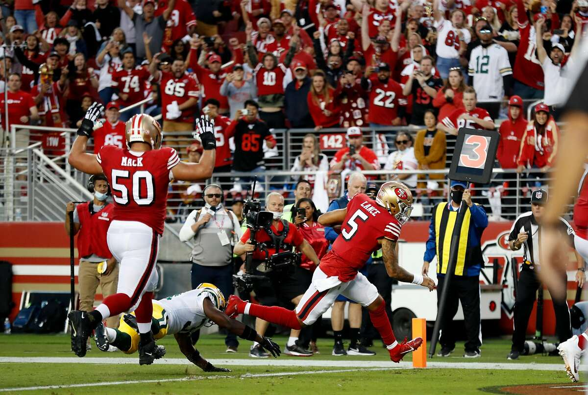 San Francisco 49ers' Trey Lance scores touchdown win final play of 1st half against Green Bay Packers during NFL game at Levi's Stadium in Santa Clara, CA on Sunday, September 26, 2021.