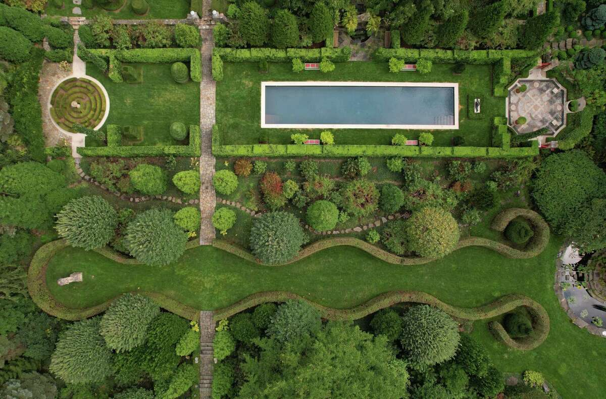 """An aerial view of the 13-acre Sleepy Cat Farm in Greenwich, Conn., photographed on Thursday, Sept. 16, 2021. Fred Landman acquired the Georgian Revival house and grounds in 1994 and collaborated with Greenwich architect Charles Hilton and landscape architect Charles J. Stick to create a majestic and magical garden that would come to be known as Sleepy Cat Farm. The property will be the subject of a book """"Sleepy Cat Farm: A Gardener's Journey,"""" to be released Oct. 19 by Monacelli Press."""