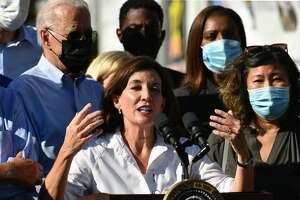 Gov. Kathy Hochul speaks, and U.S. President Joe Biden, as he tours a neighbourhood affected by Hurricane Ida in Queens, New York on September 7, 2021.